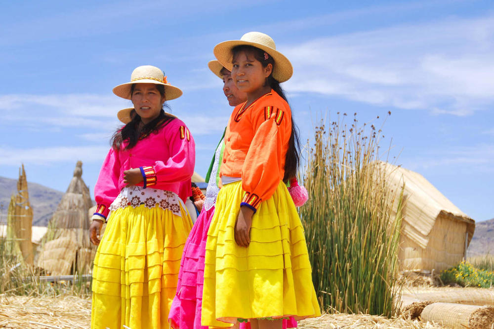 Peru lake titicaca unidentified women in traditional dresses welcome tourists in uros island20180829 76980 1qeb8y0