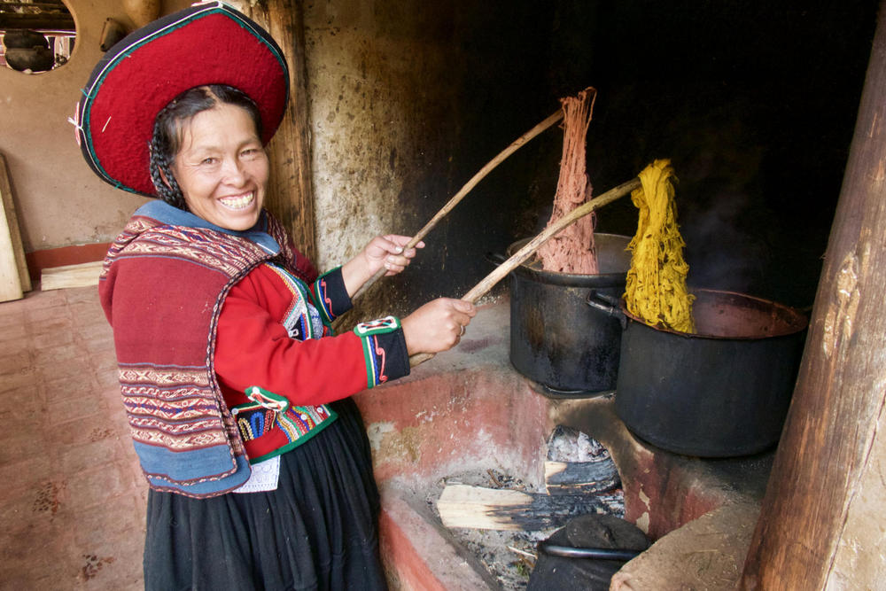 Peru sacred valley chinchero weaver dying wool over stove20180829 76980 ix9fjt