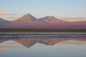 Chile atacama sunset lagoons with volcanoes