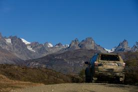 Chile patagonia carretera austral dirty car crest of hil san lorenzo massif in distance c pura aventura thomas power