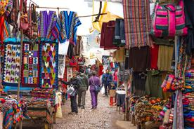 Peru sacred valley european travellers walking and shopping local peruvian products pisac market scared valley3 020180829 76980 15mkmhl