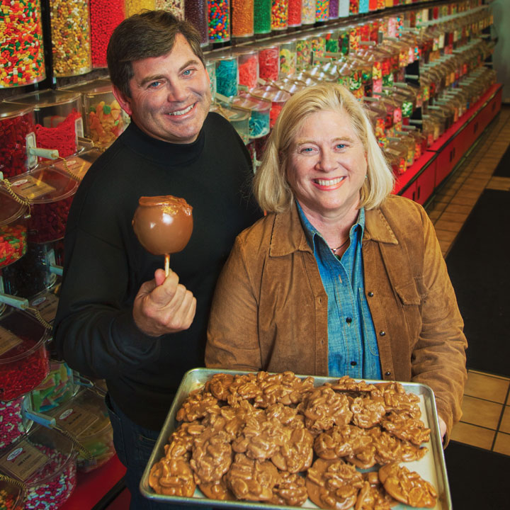 Tim and Jennifer with candy apple and pralines