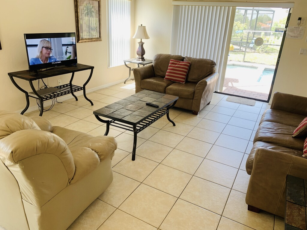 Family room with view of the pool area