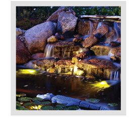 How can I make my water garden more enjoyable for night time viewing?