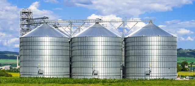 As you drive through the Midwest, you will see tall, silver, cylinder-like bins on most farms. These built structures are...