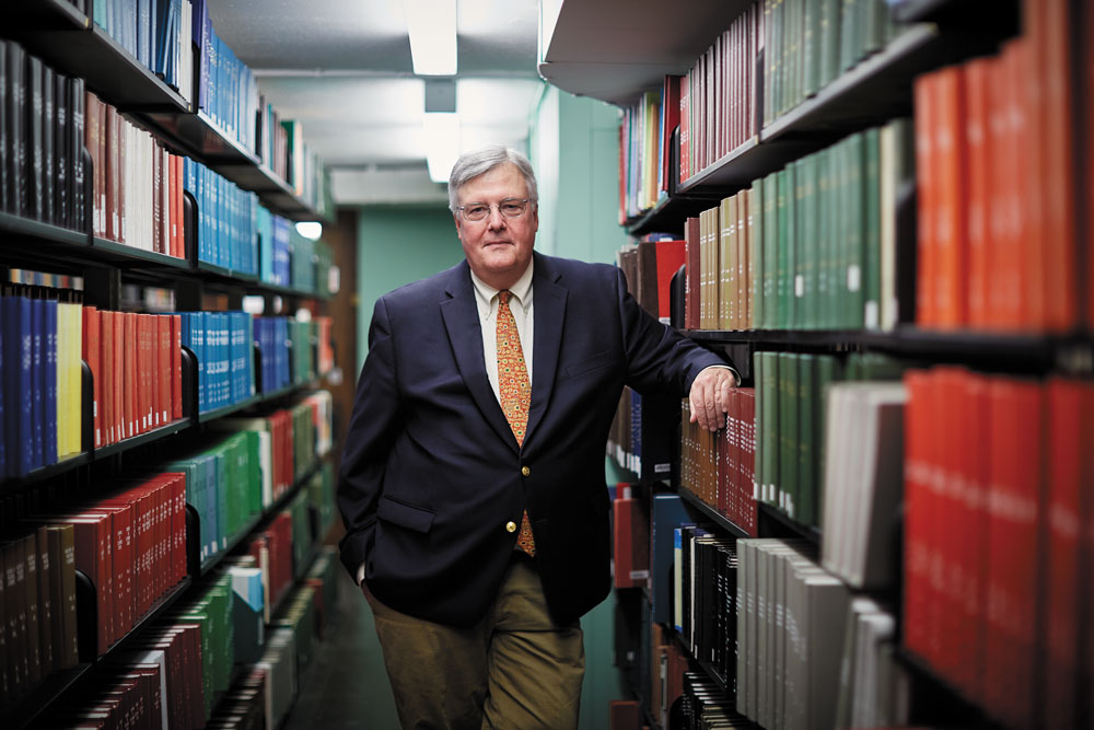 Dean of Libraries John M. Unsworth amid Old Stacks' metal support shelves