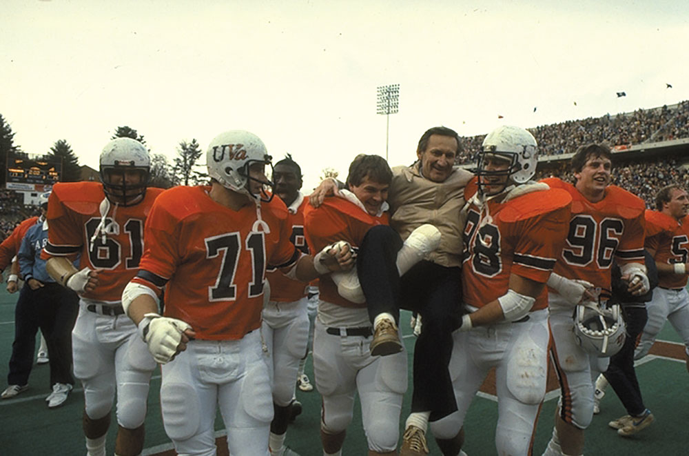 Players carry coach Welsh off the field after a 17-14 win in 1983 snaps a 9-game losing streak against UNC.