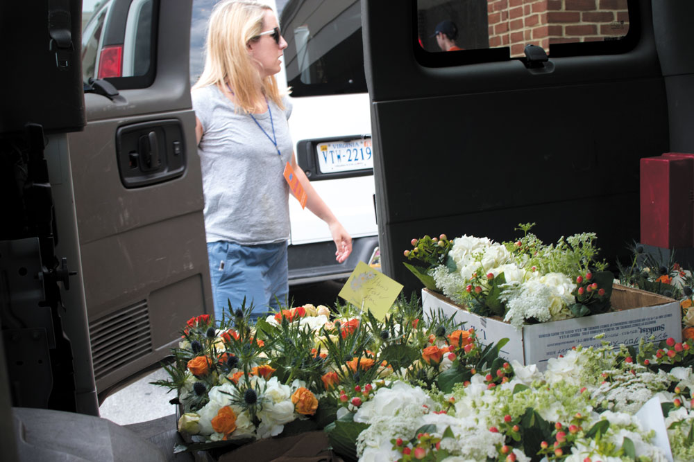 Mary Elizabeth Luzar and the team pack up three vans for flower delivery to multiple events across the Grounds.