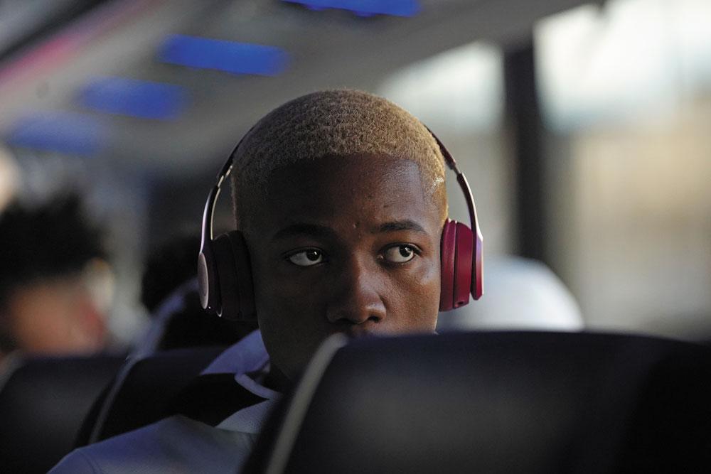 Redshirt junior Mamadi Diakite on the team bus