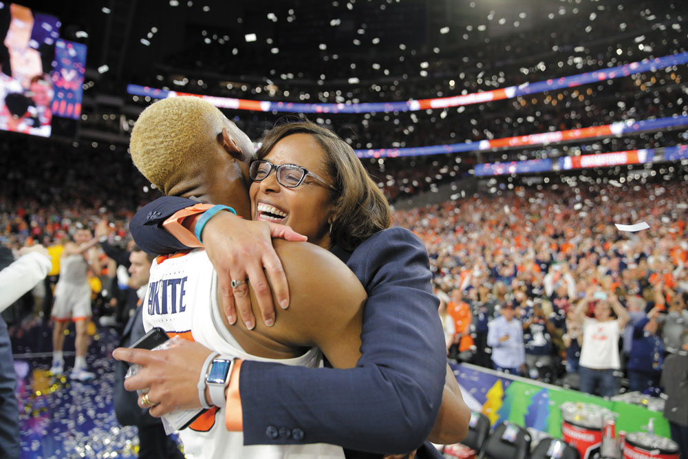 Diakite and Athletic Director Carla Williams hug