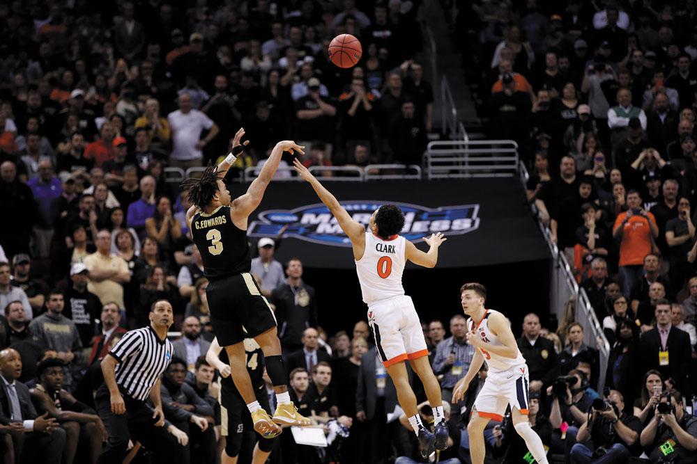 Purdue's Carsen Edwards shoots over UVA freshman Kihei Clark