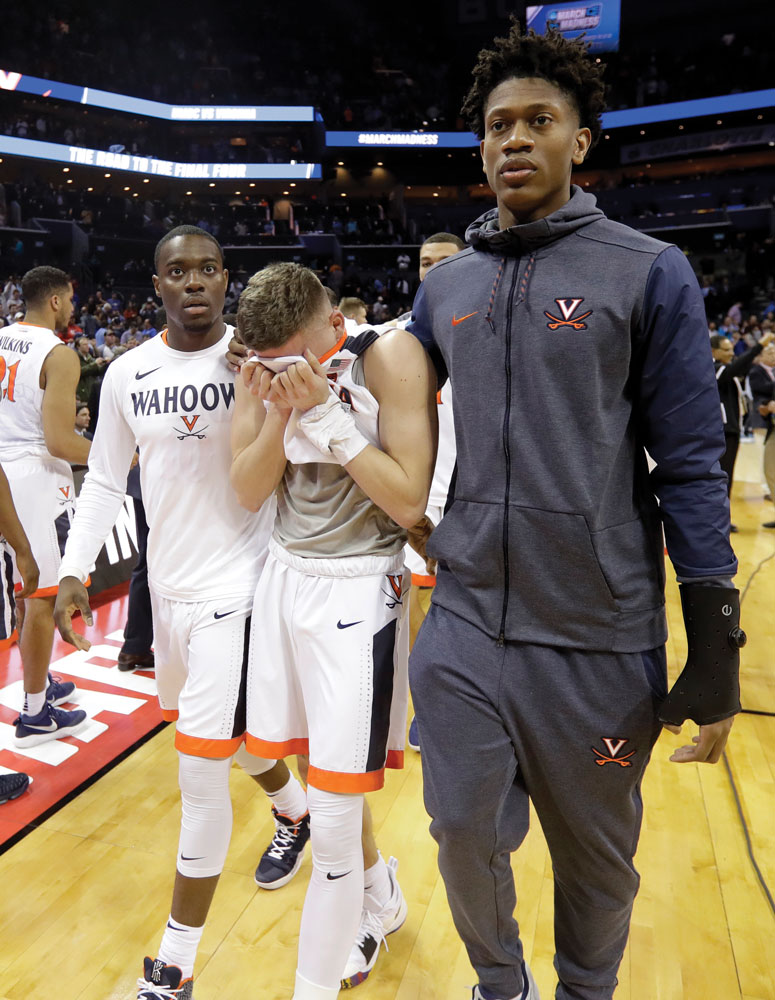 UVA players leave the court after the historic March 2018 loss to No. 16-seed UMBC