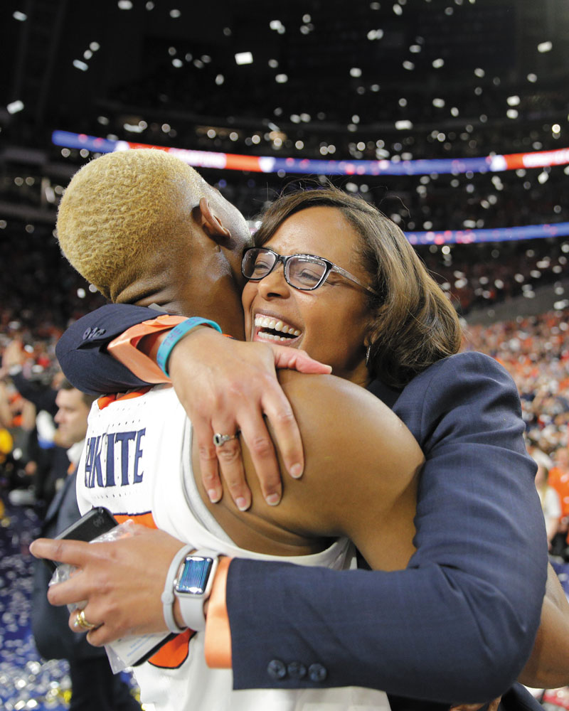 Mamadi Diakite and Carla Williams hug after the men's basketball team won the national championship