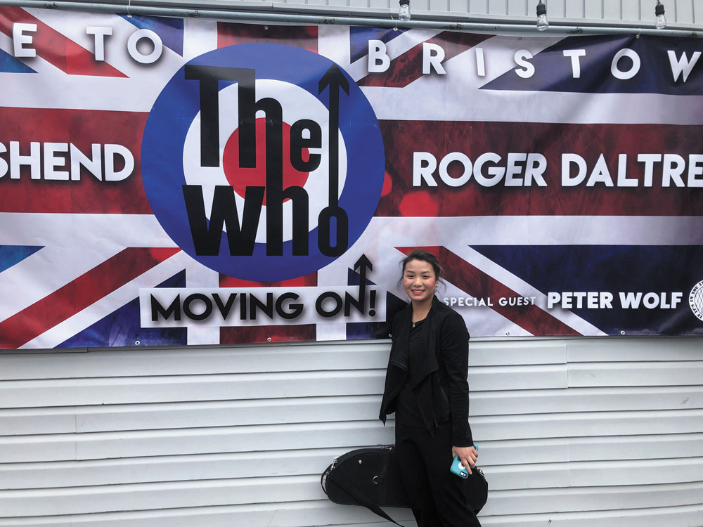 Olivia Scheidt in front of a The Who poster