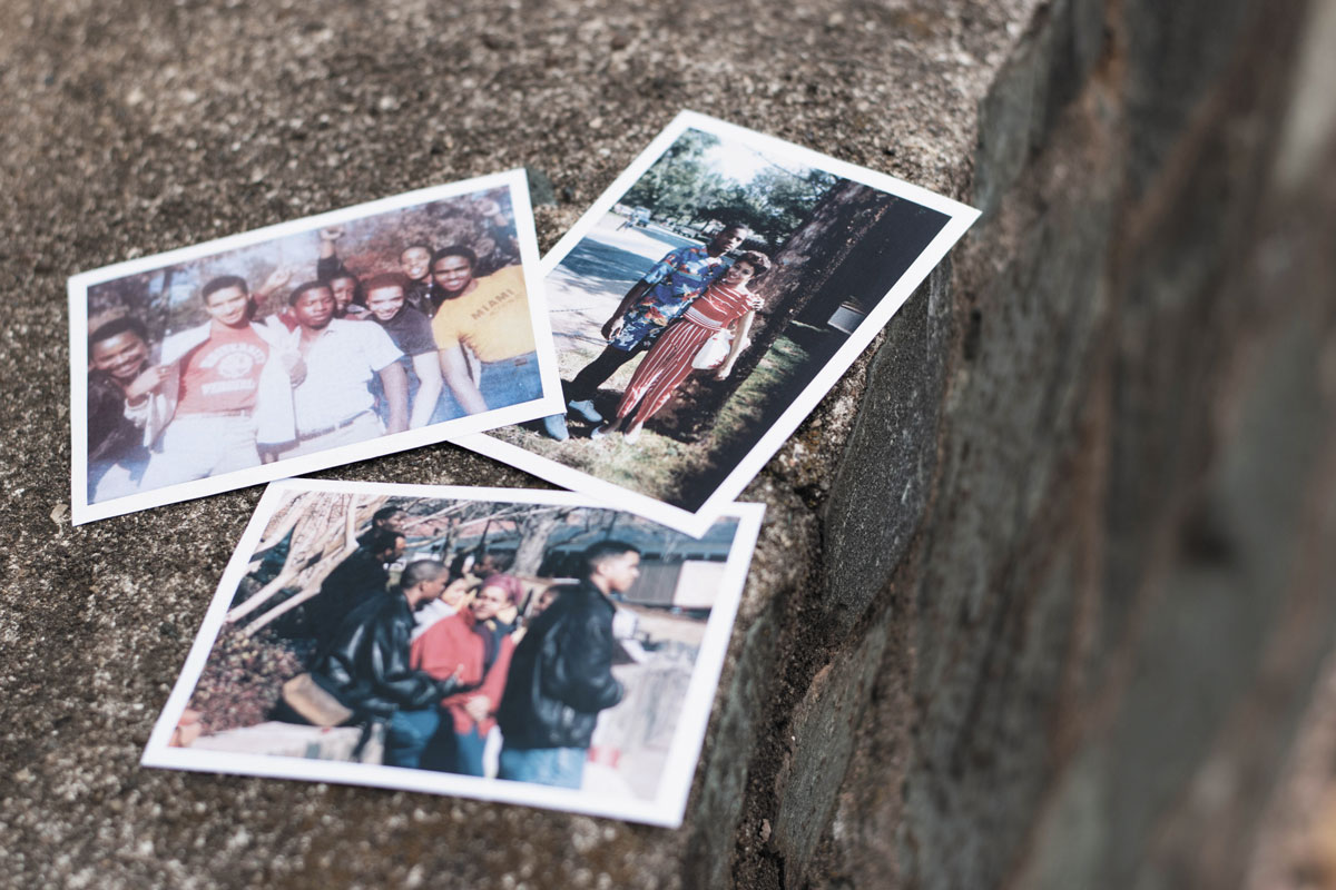 Collage of photos on the rock wall at what has been known as the Black Bus Stop