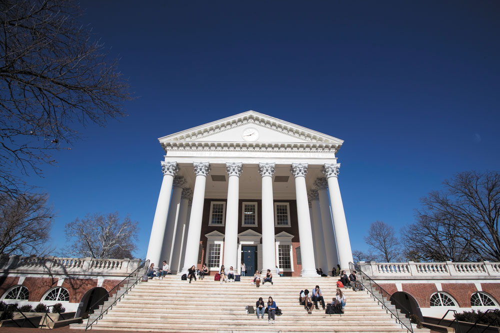 Students sitting on the steps of the Rotunda on a blue-sky day