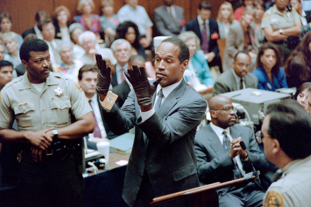 O.J. Simpson attempts to put on the infamous gloves during his trial