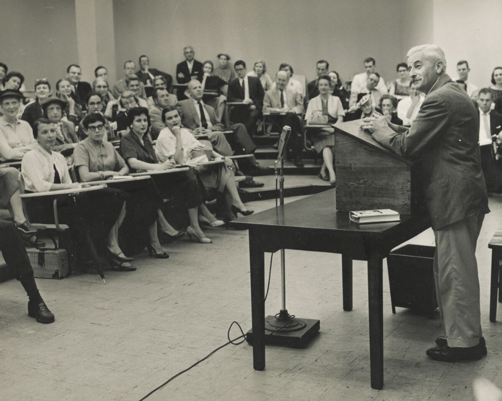 William Faulkner speaking to a classroom