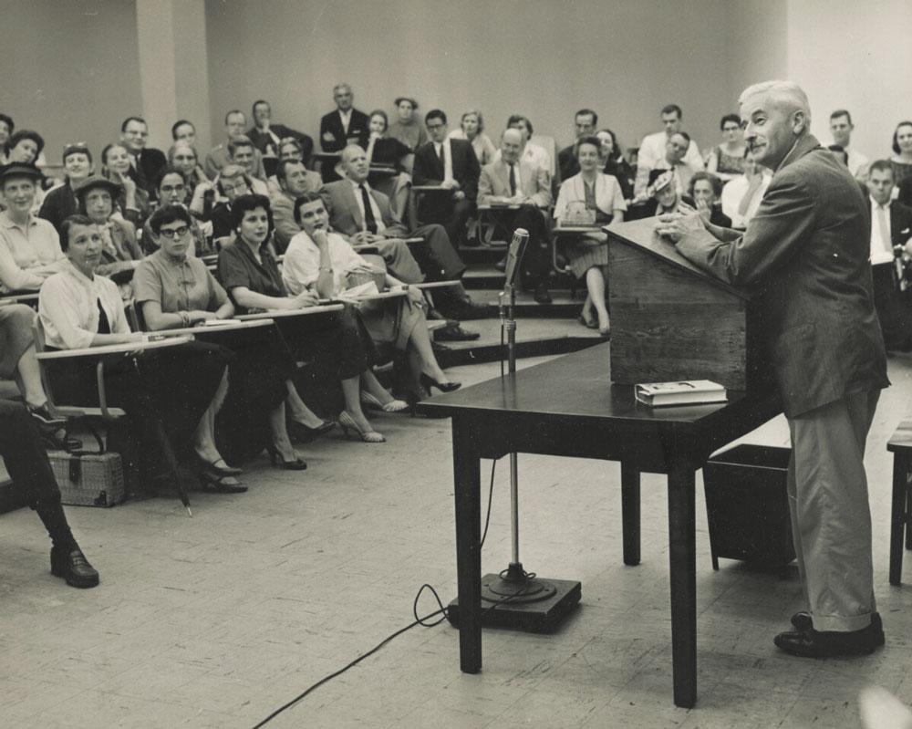 William Faulkner speaking to a classroom