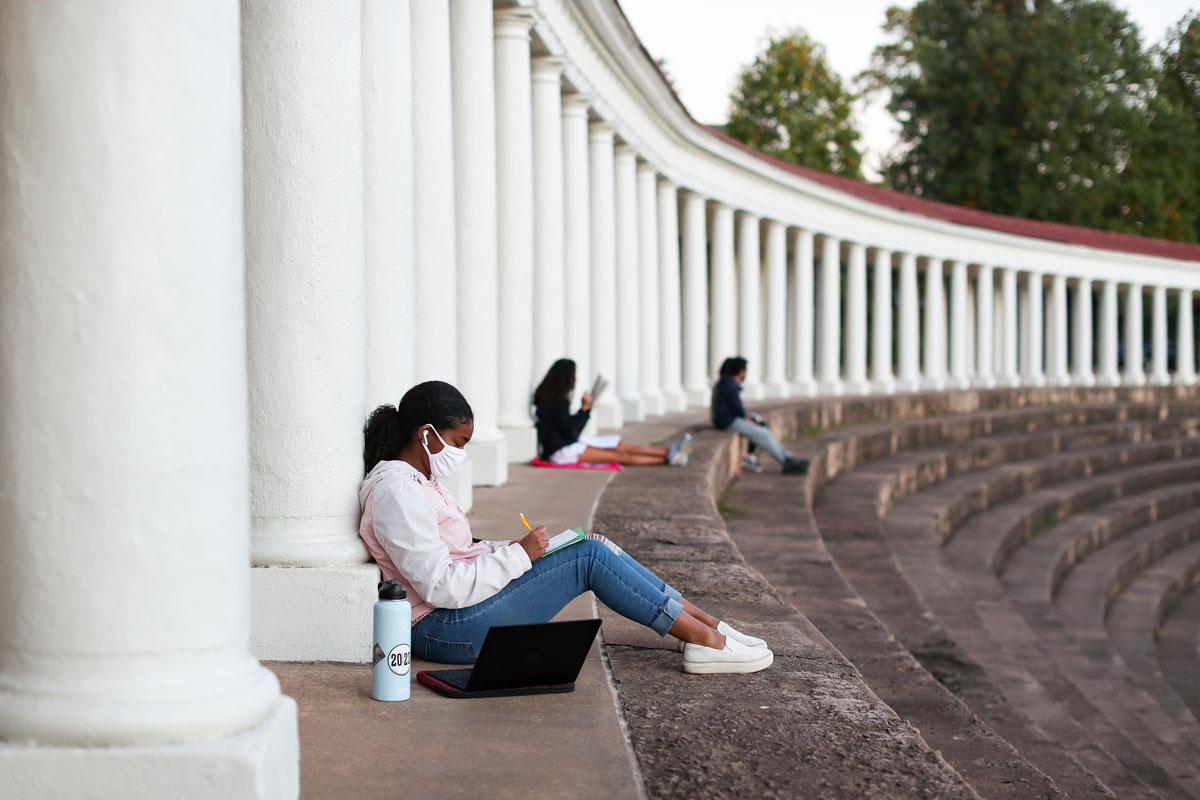 Students doing schoolwork while sitting on the steps of the Lambeth colonnade