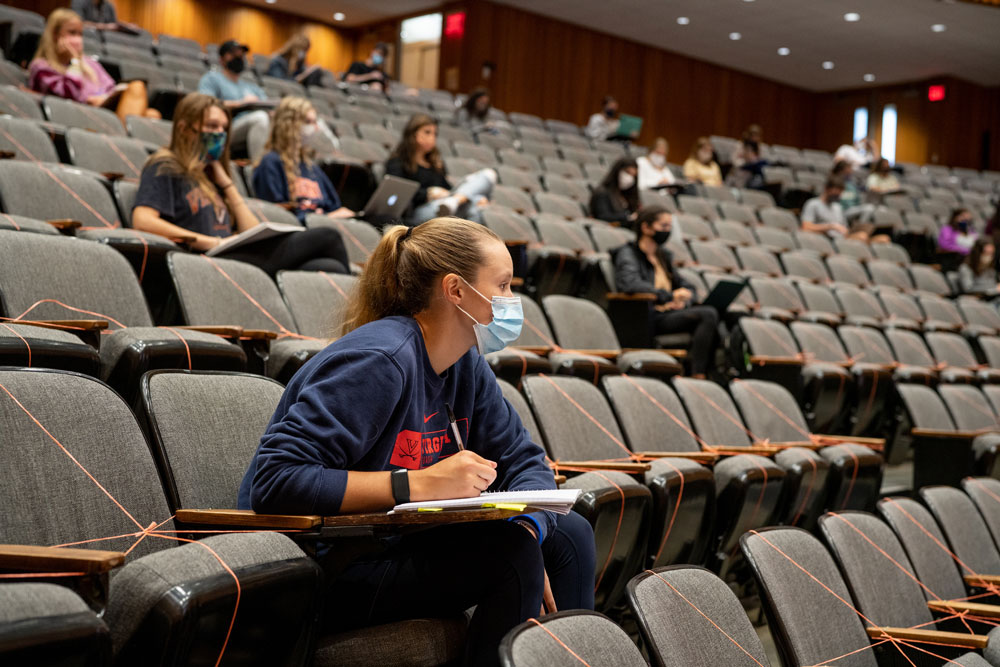 Masked, distanced students attend a lecture class