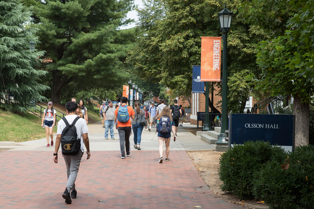 Students walking by Olsson Hall