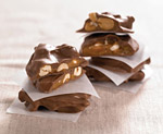 12-24 oz. Tins Choc. Covered Peanut Brittle (one case)