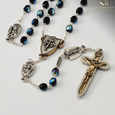 The Warrior's Rosary for Women - Black Bohemian Glass Faceted beads with Aurora Borealis effect. Crucifix and centerpiece are a two tone antique gold and silver finish 