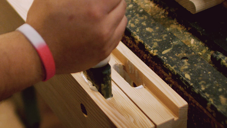 Glue being applied within mortise on door stile.