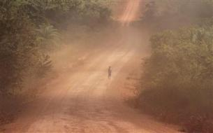 A boy walks on the Trans-Amazonian highway in Itaituba, in the state of Para May 24, 2012. REUTERS-Nacho Doce