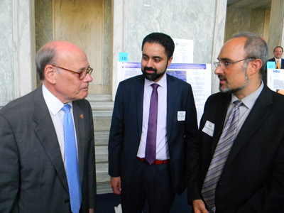 Cong. Steve Cohen (D-TN), left, speaks with Sumit Sharma, MD (Cleveland Clinic/Cole Eye Institute), and Shefa Gordon, PhD, NEI's Director of the Office of Program Planning and Analysis