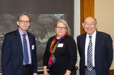 Featured speaker Paul Lee, MD, JD (Kellogg Eye Institute/University of Michigan, right) with Research to Prevent Blindness President Brian Hofland, PhD (left) and Acting Deputy NEI Director Mary Frances Cotch, PhD (center)