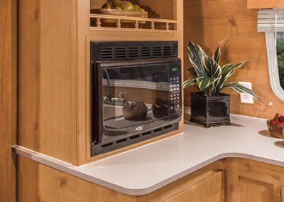 2016-Riverside-RV-Retro-199FKS-Kitchen-Cabinets