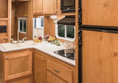 2017-Riverside-RV-Retro-265RB-Kitchen-Cabinets
