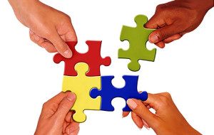 people sharing puzzle pieces