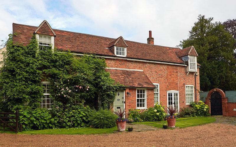 exterior brick home The Cottage UK - LuxuryRehabs.com