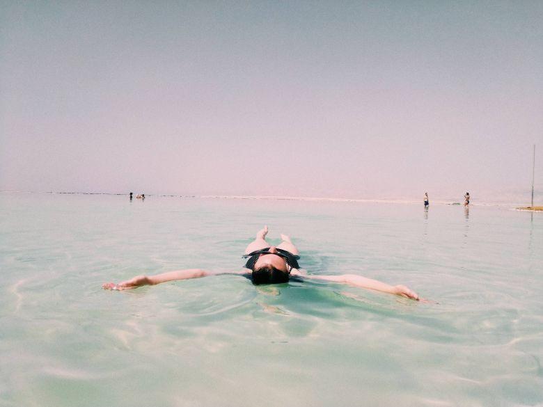 woman floating in dead sea