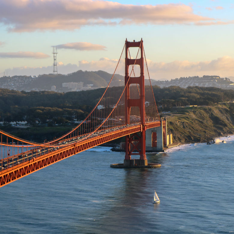landscape shot of Golden Gate Bridge, San Francisco Bay and mountains