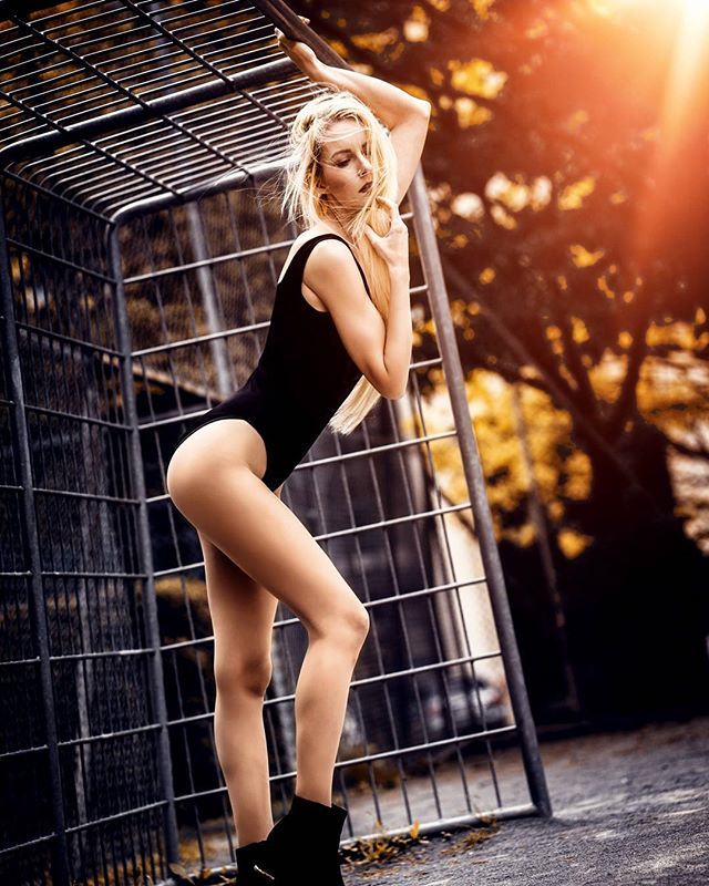 colors boots cage goal legs sun spring lights outdoor cloudy black football availablelight perfect slim colorful photography fashion tall model girl body sunset photoshop portrait blonde beauty field woman perfectbody