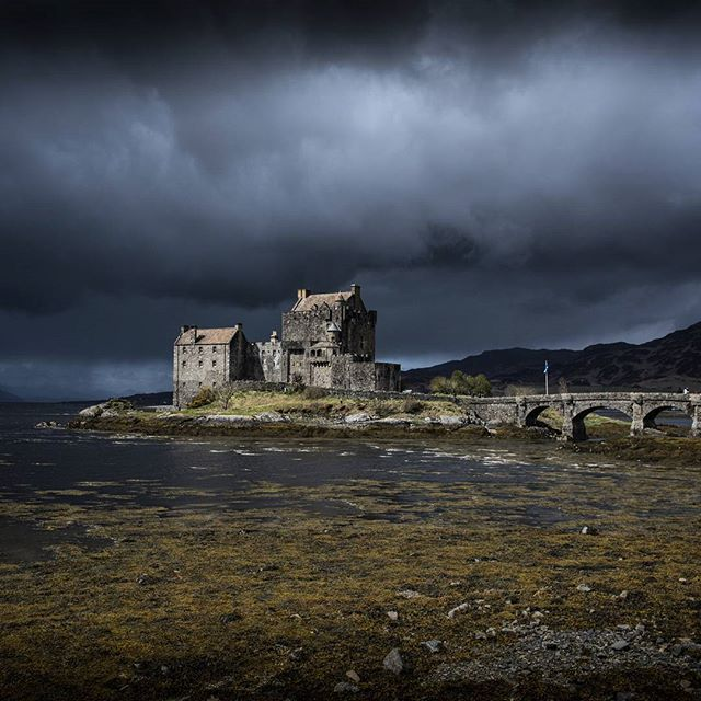 highlander eileandonancastle highlands scotland clouds castle dark
