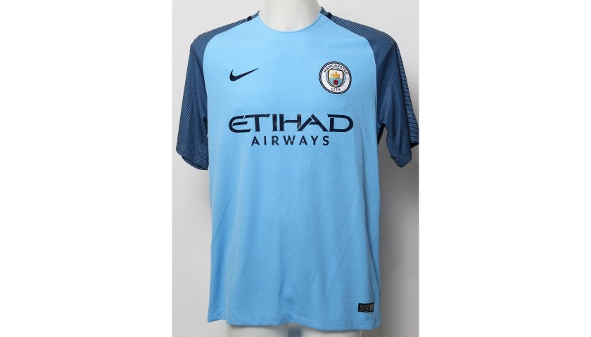 hot sale online 668b3 0a535 Vincent Kompany Manchester City FC Worn Shirt and Shorts from Season  2016|17 - CharityStars