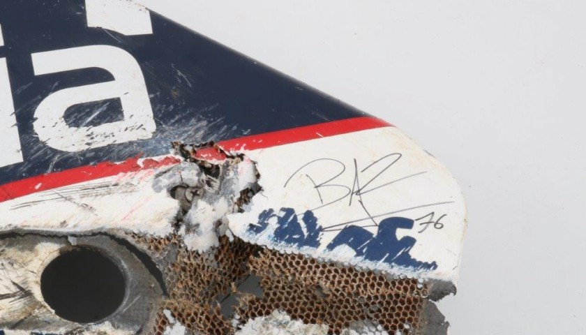 Ducati Motodress used by Loris Baz, signed by Loris Baz and Hector Barbera