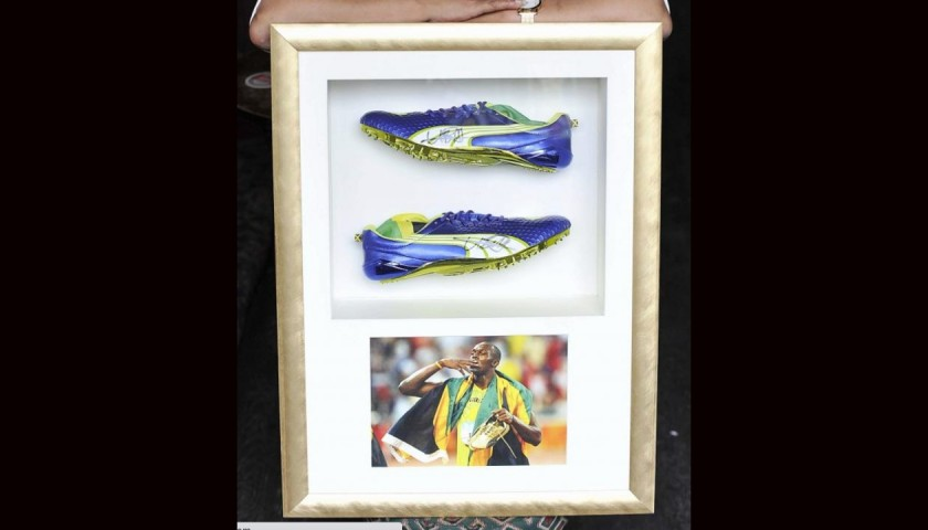 Usain Bolt Worn and Signed Running Spikes