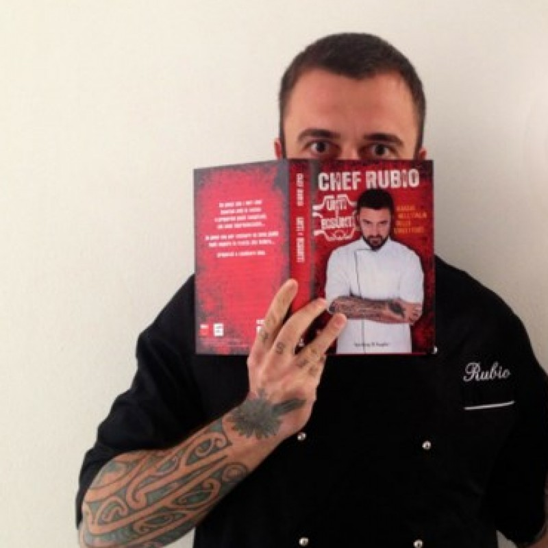 Chef Rubio gives you the first copy of his book and his chef uniform