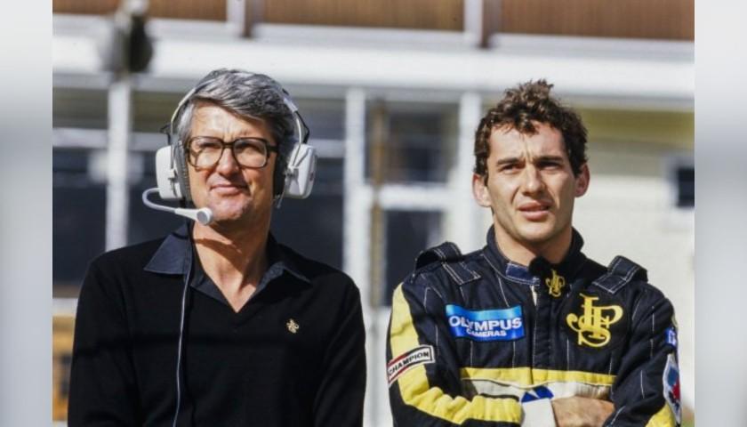 Peter Warr Team Lotus Waterproof Race Suit, 1986 - Signed by Ayrton Senna
