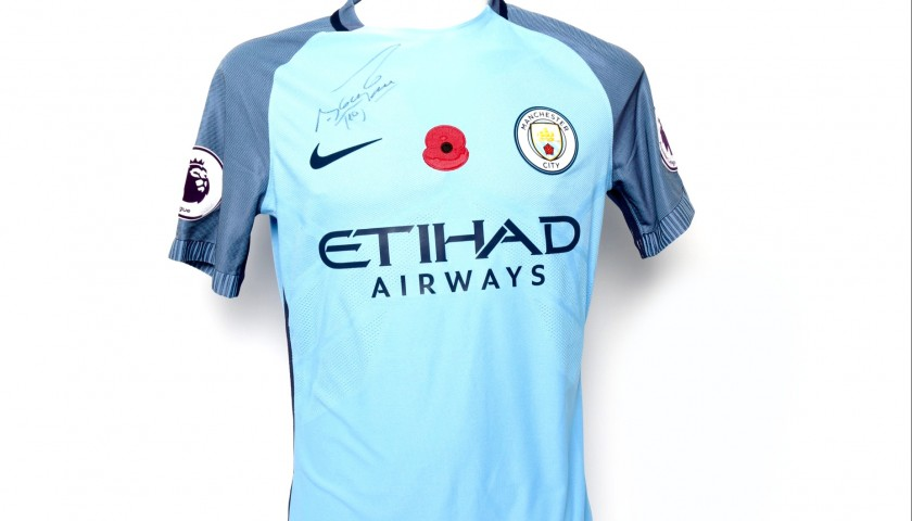 quality design 7b14d ef3f3 Kun Aguero Worn and Signed Manchester City Poppy Shirt - CharityStars