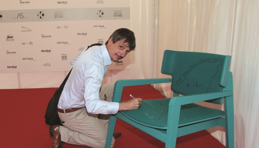 Offset Montbel armchair signed by the artists during the Venice Film Festival 2016, among all Bellucci, Watson and Wenders