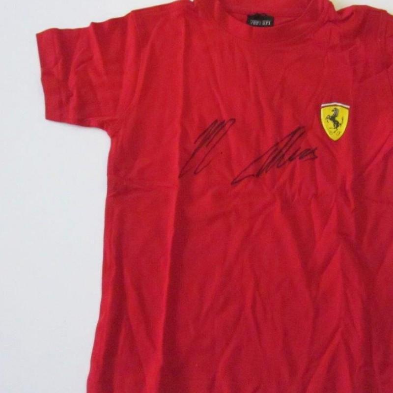 Ferrari childs t-shirt signed by Alonso and Räikkönen