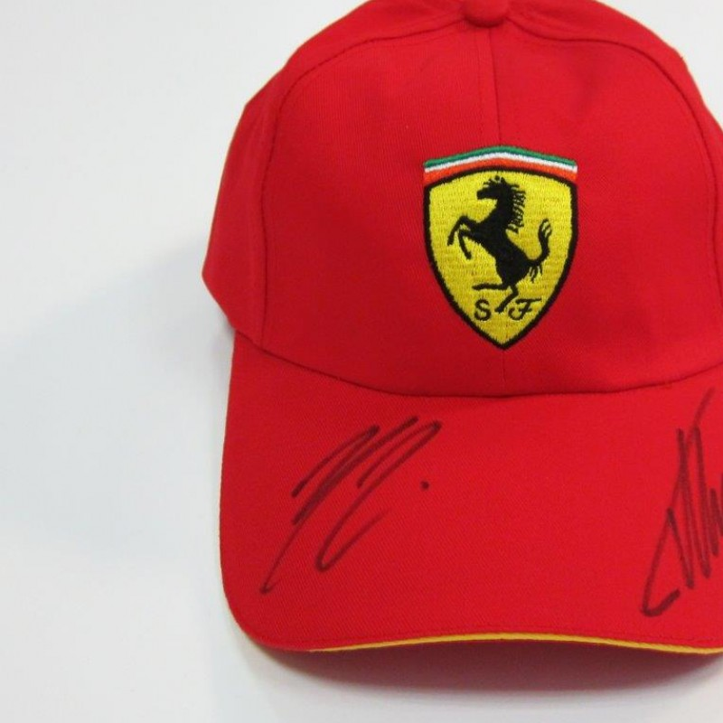 Ferrari hat signed by Alonso and Raikkonen