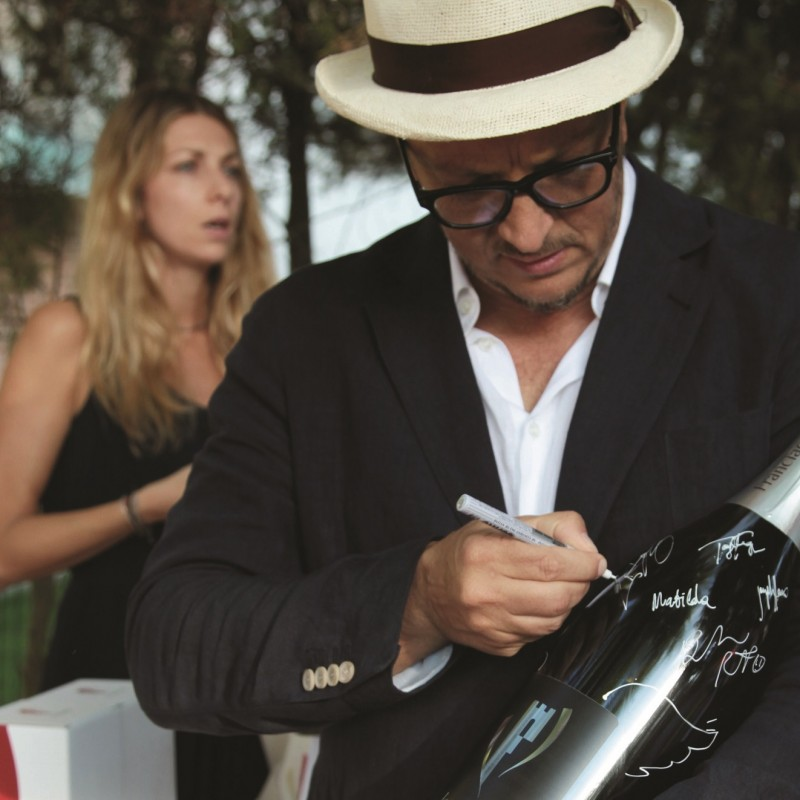Franciacorta factice bottle signed by actors and directors during Mostra del Cinema in Venice 2016